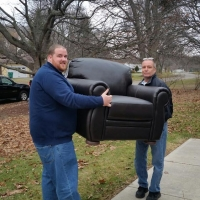 Lakeside Staff Phil & Mike delivering New leather chair to CDS